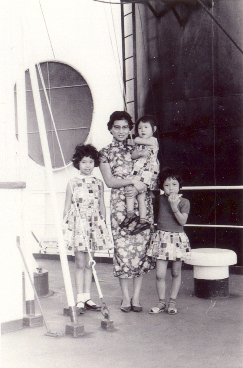 Mrs. Ruth Mulan Chu Chao and 3 daughters aboard the cargo ship that brought them to America.