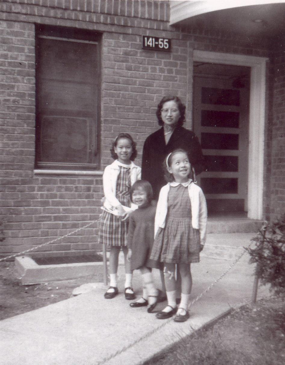 Mrs. Ruth Mulan Chu Chao with their 3 daughters in front of their first apartment building in America in Queens, New York.