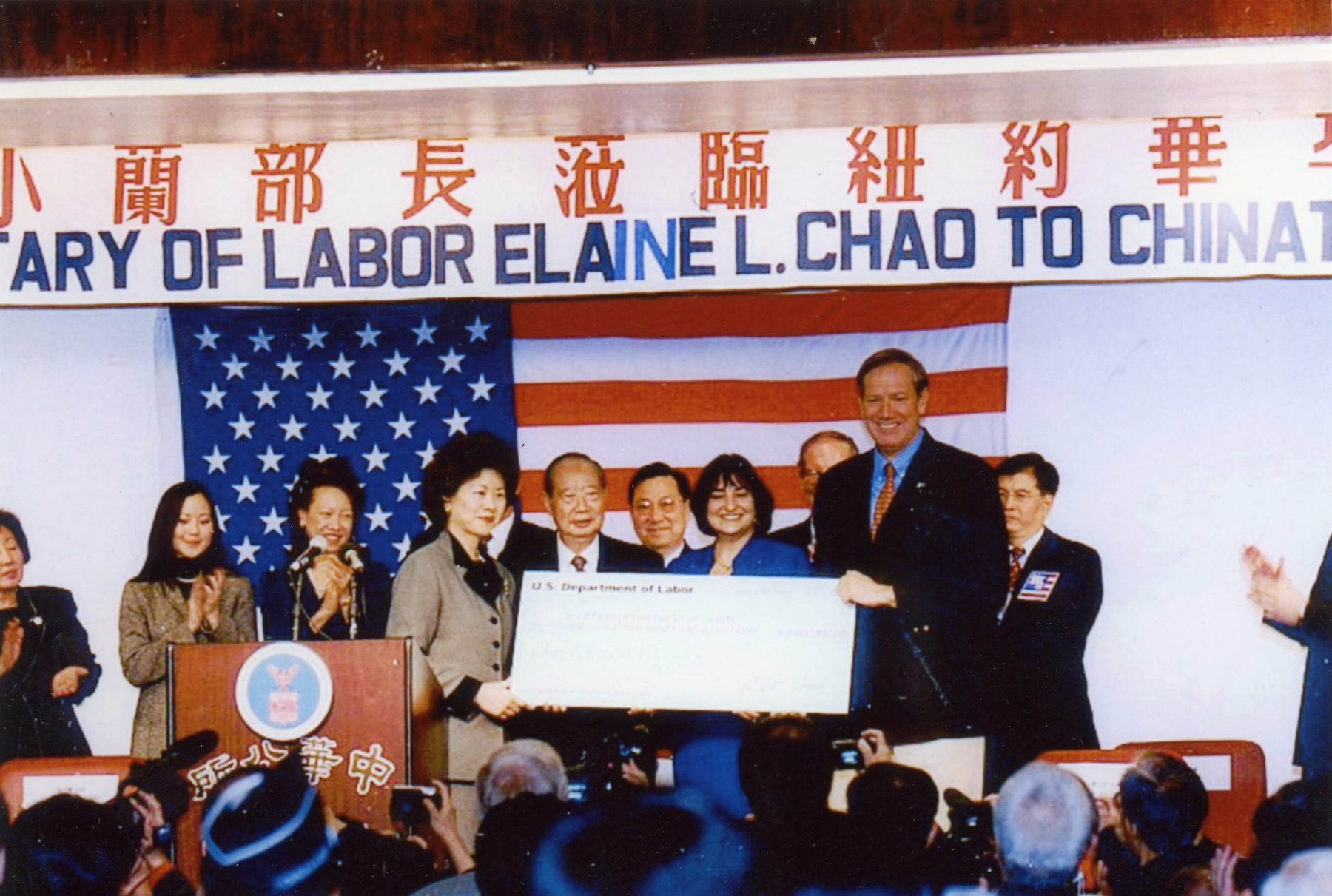 Secretary of Labor Elaine Chao presenting a check for $1,000,000 to Chinatown to help residents recover from the economic devastation of the attacks of September 11, 2001 with New York Governor George Pataki.
