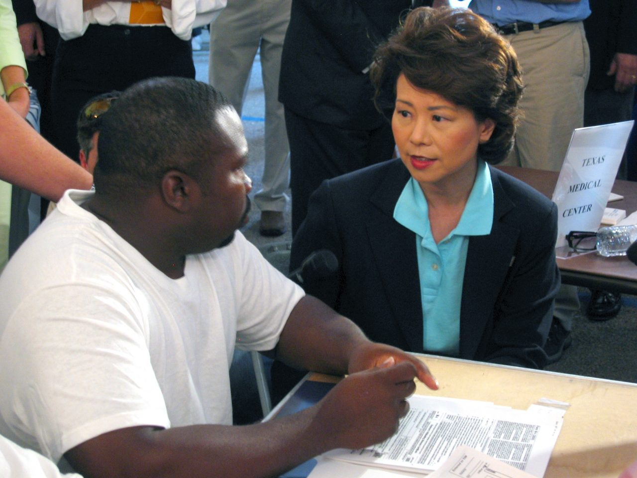 Secretary Elaine Chao talking to a displaced worker at an employment center in the gulf region after Hurricane Katrina.