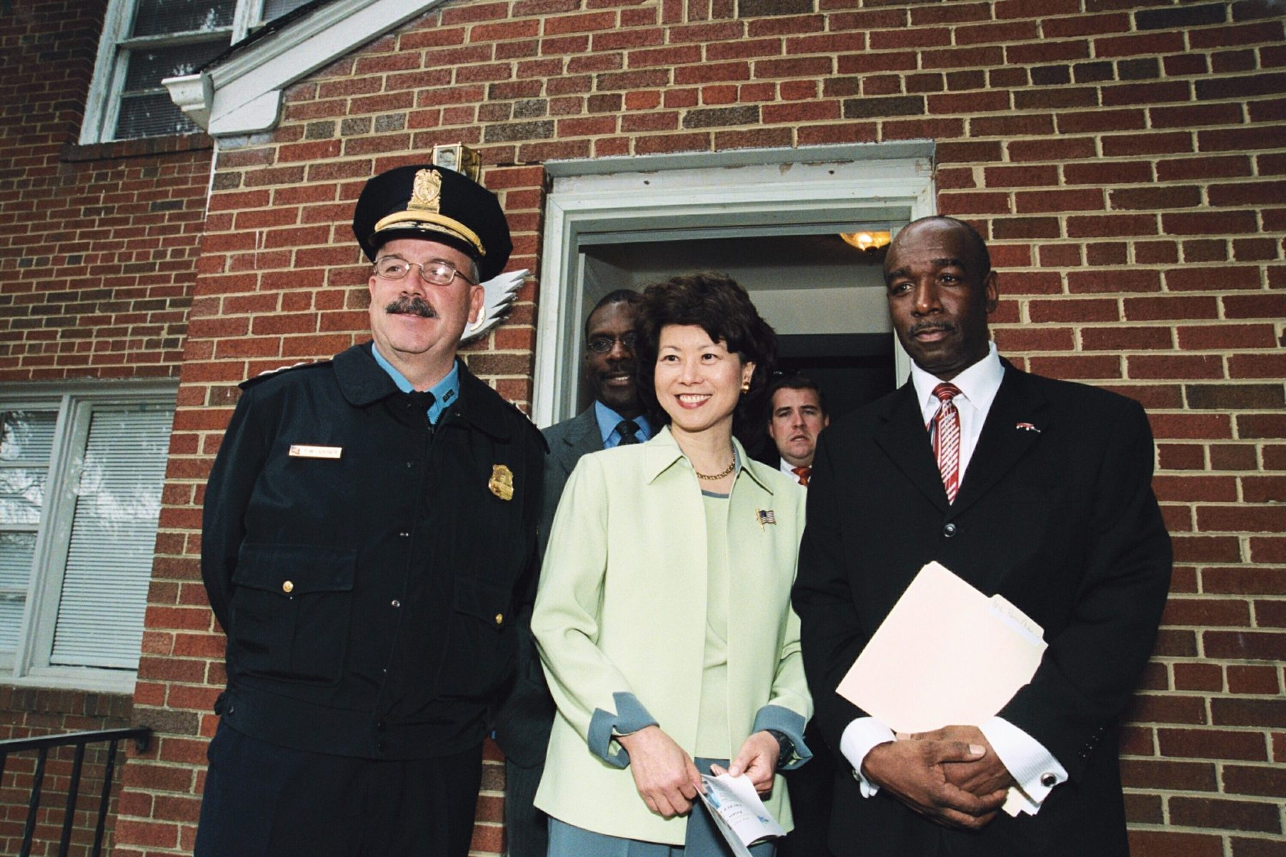 Secretary Elaine Chao celebrating the partnership between faith-based and community organizations and D. C. law enforcement to help ex-offenders gain employment and re-integrate into their communities.
