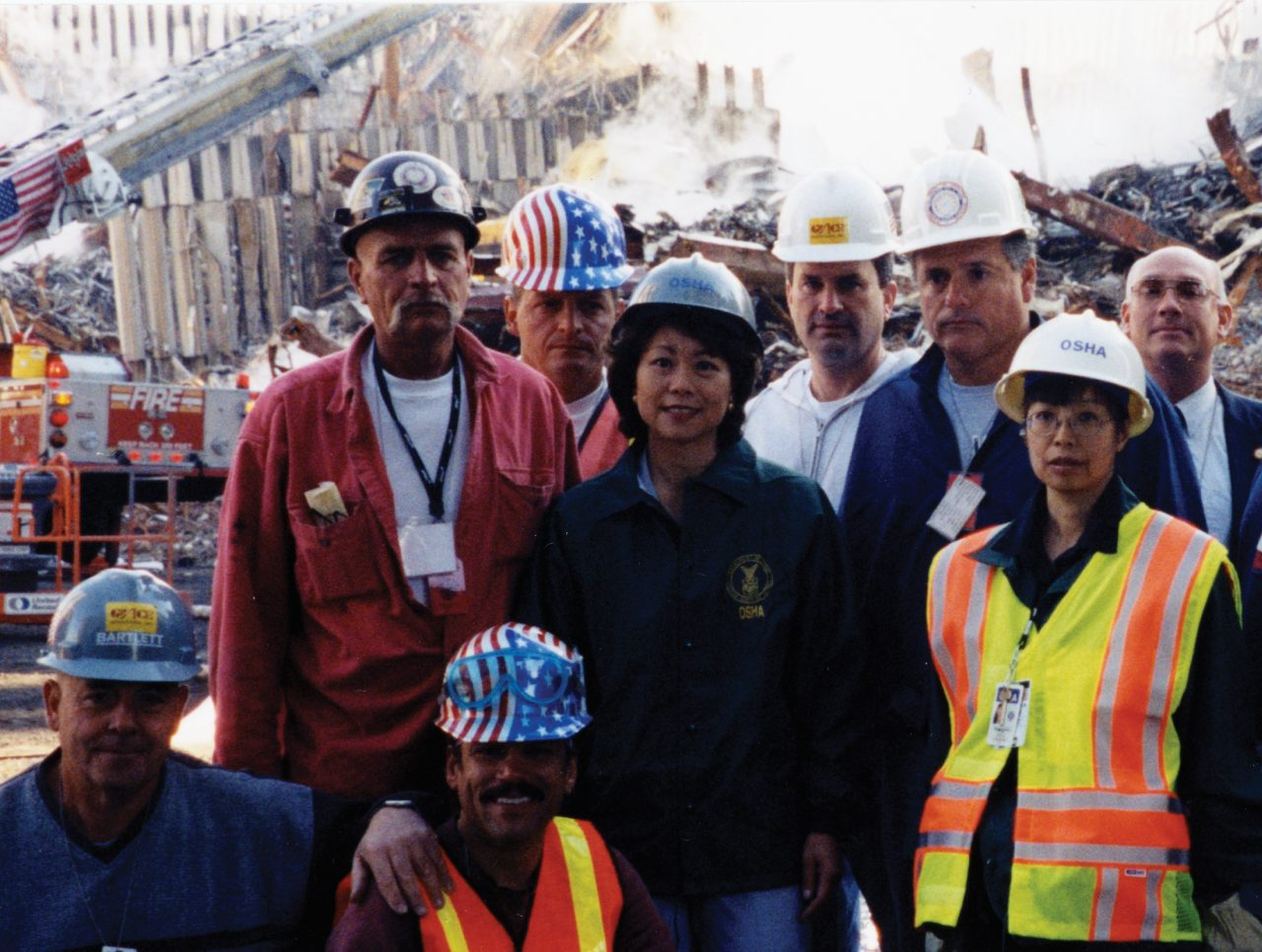 Secretary Elaine Chao with OSHA colleagues and workers at Ground Zero after 9/11/01.