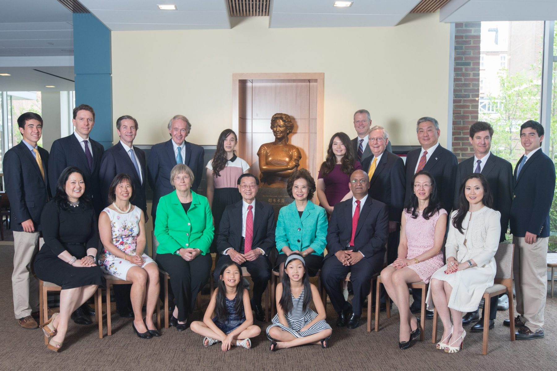 Dr. James S. C. Chao and the Honorable Elaine Chao with dignitaries & family at the Dedication of the Ruth Mulan Chu Chao Center, Harvard University besides the specially commissioned bronze sculpture of Mrs. Ruth Mulan Chu Chao.