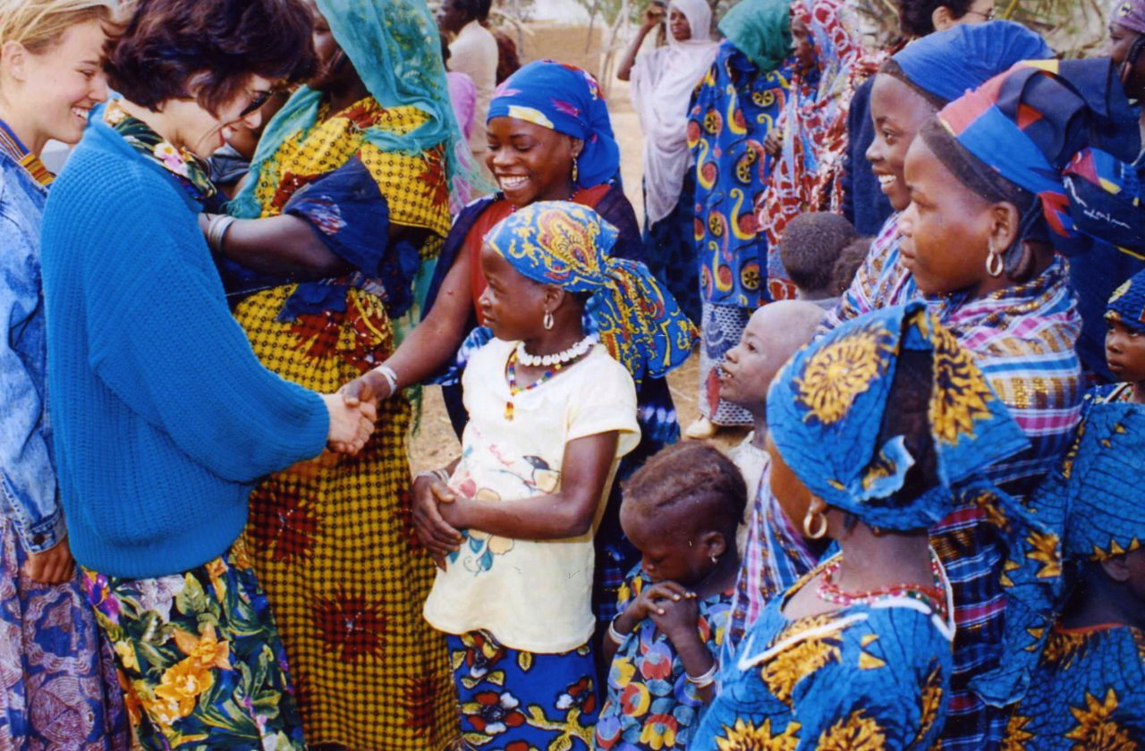 Peace Corps Director Elaine Chao visiting Peace Corps Volunteers and village children in Niger.