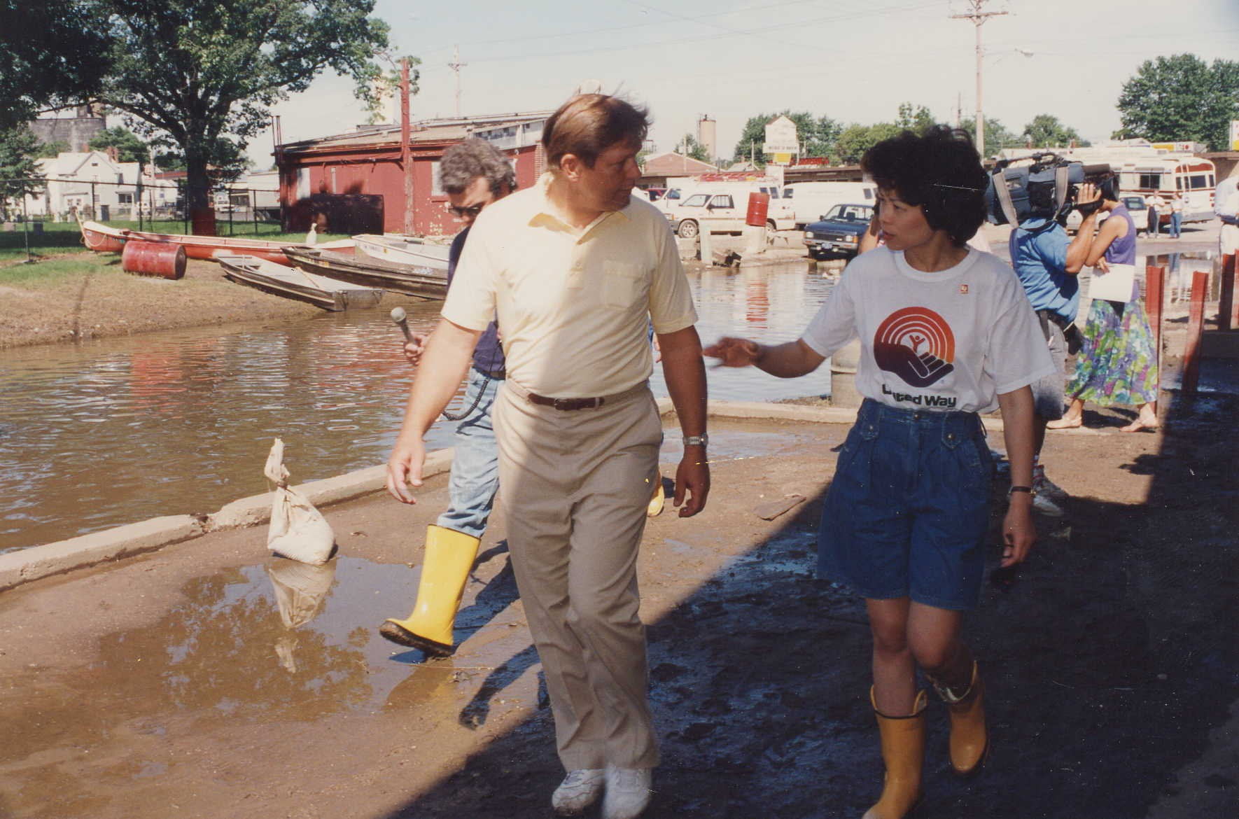 United Way of America President & CEO Elaine Chao talking with a local official during a tour to a flooded region in the Midwest.