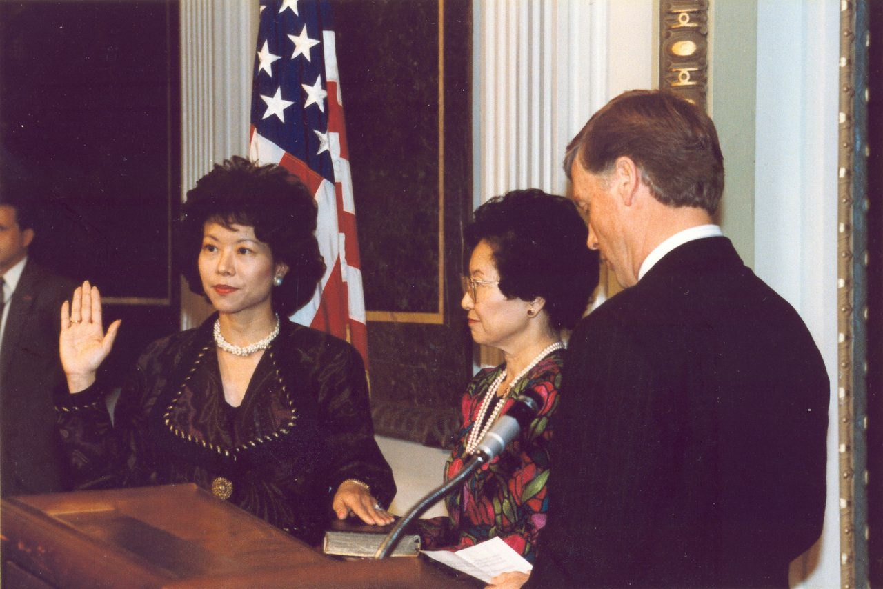 Elaine Chao being sworn in by Vice President Dan Quayle as the first Asian Pacific American Director of the Peace Corps.