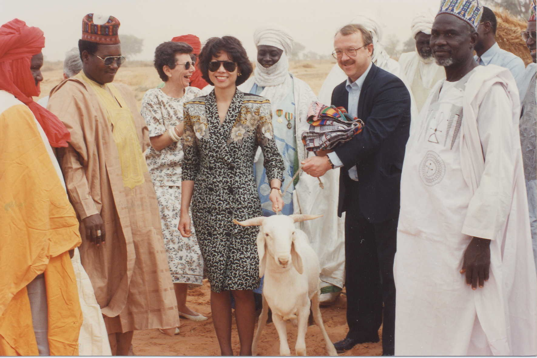 Peace Corps Director Elaine Chao presented with a goat by village elders upon her arrival in Niger.