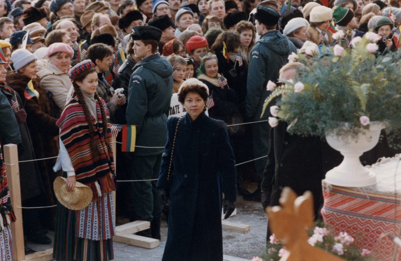 Peace Corps Director Elaine Chao, passing before a crowd in Vilnius, Lithuania excitedly awaiting a major address by the American Vice President.