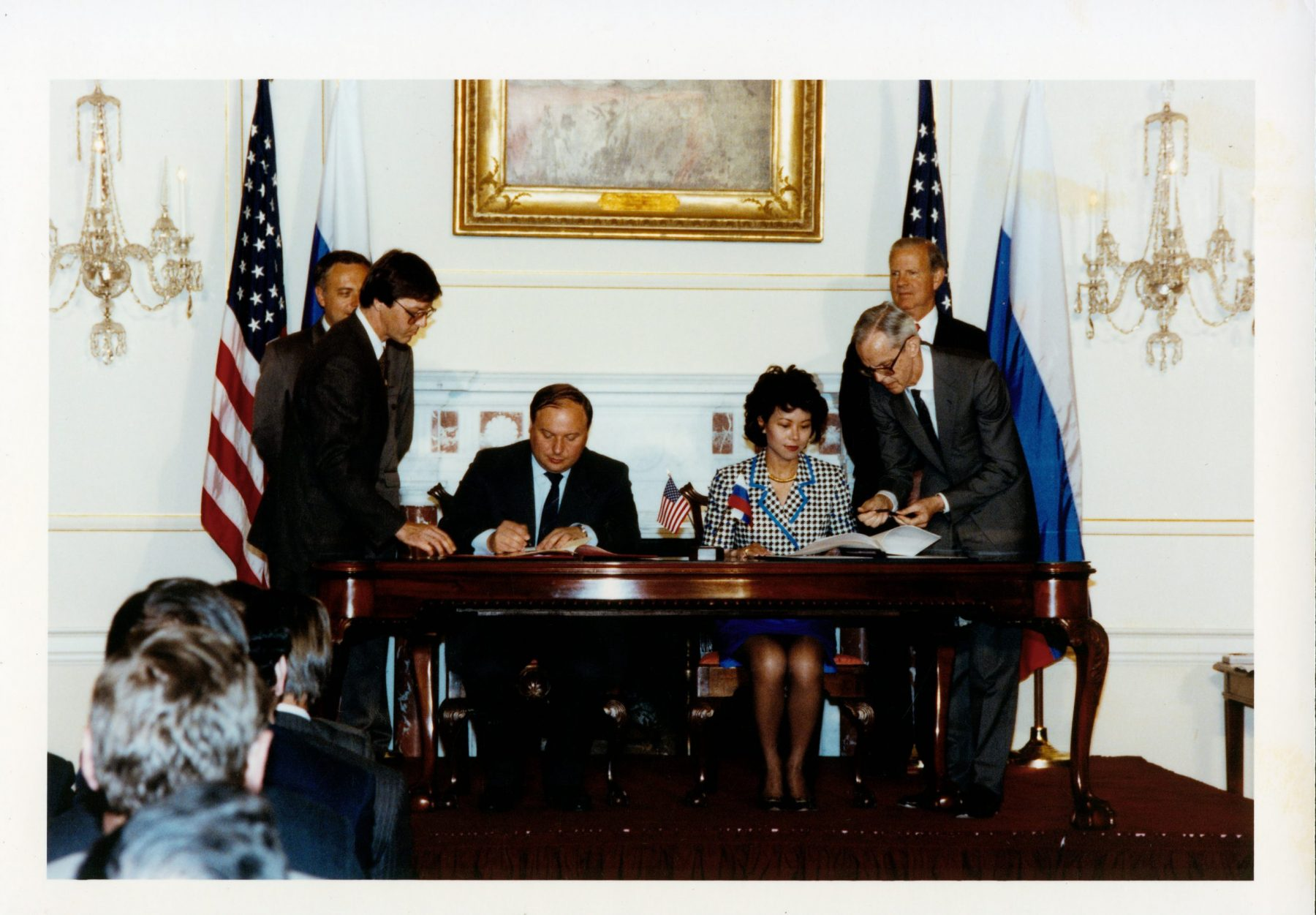 Peace Corps Director Elaine Chao signing the Peace Corps country agreement with Russian Prime Minister Yegor Gaidar.
