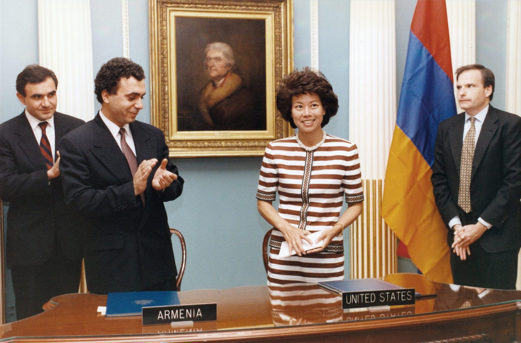 Peace Corps Director Elaine Chao signing the Peace Corps country agreement with Armenian Prime Minister Hrant Bagratyan.