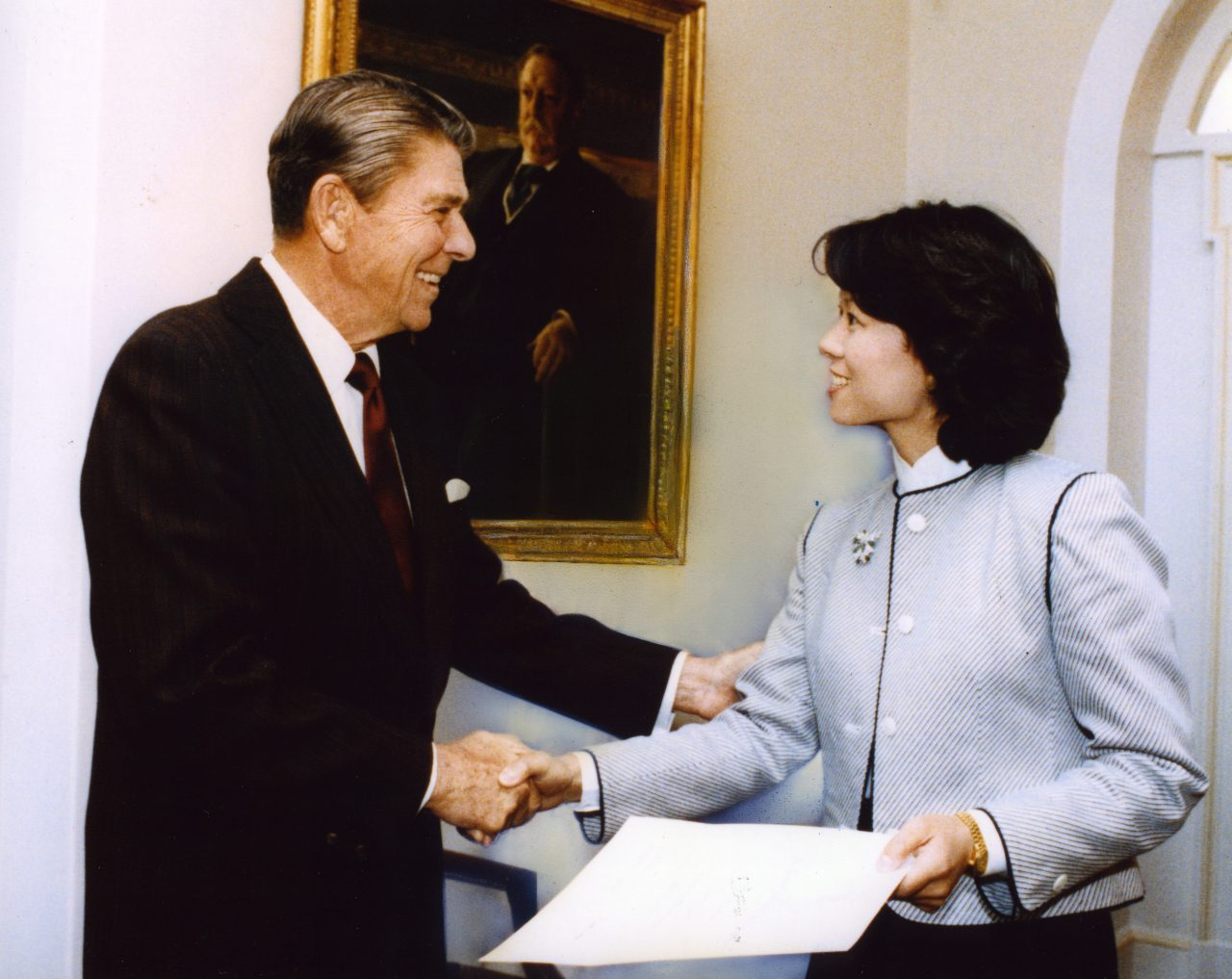 Elaine Chao receiving her White House Fellow certificate from President Ronald Reagan in the Cabinet Room of the White House, where years later, Elaine would attend cabinet meetings as the Secretary of Labor & then, as Secretary of Transportation.