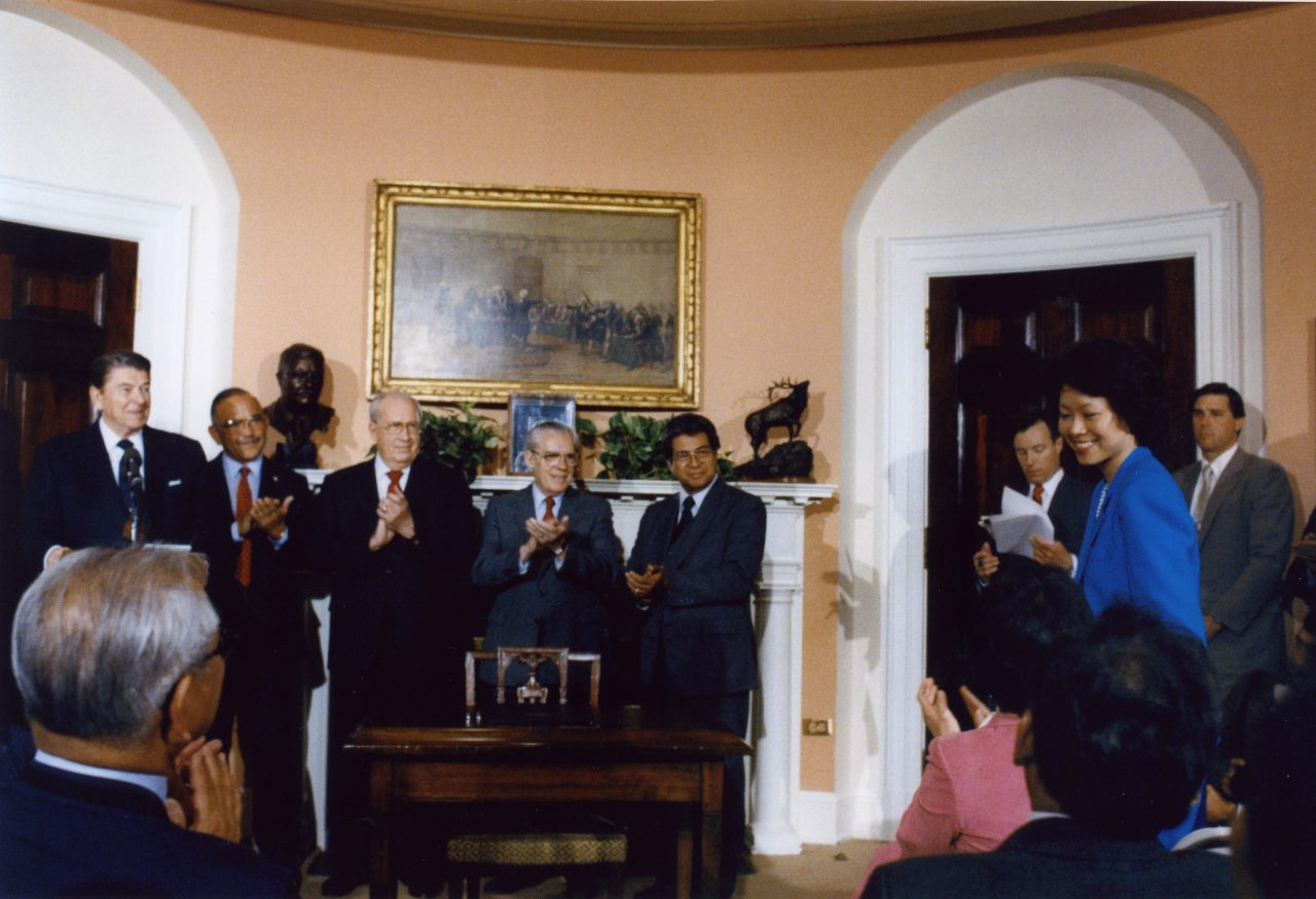Deputy Maritime Administrator Elaine Chao being acknowledged by President Ronald Reagan at an event in the Roosevelt Room at The White House.