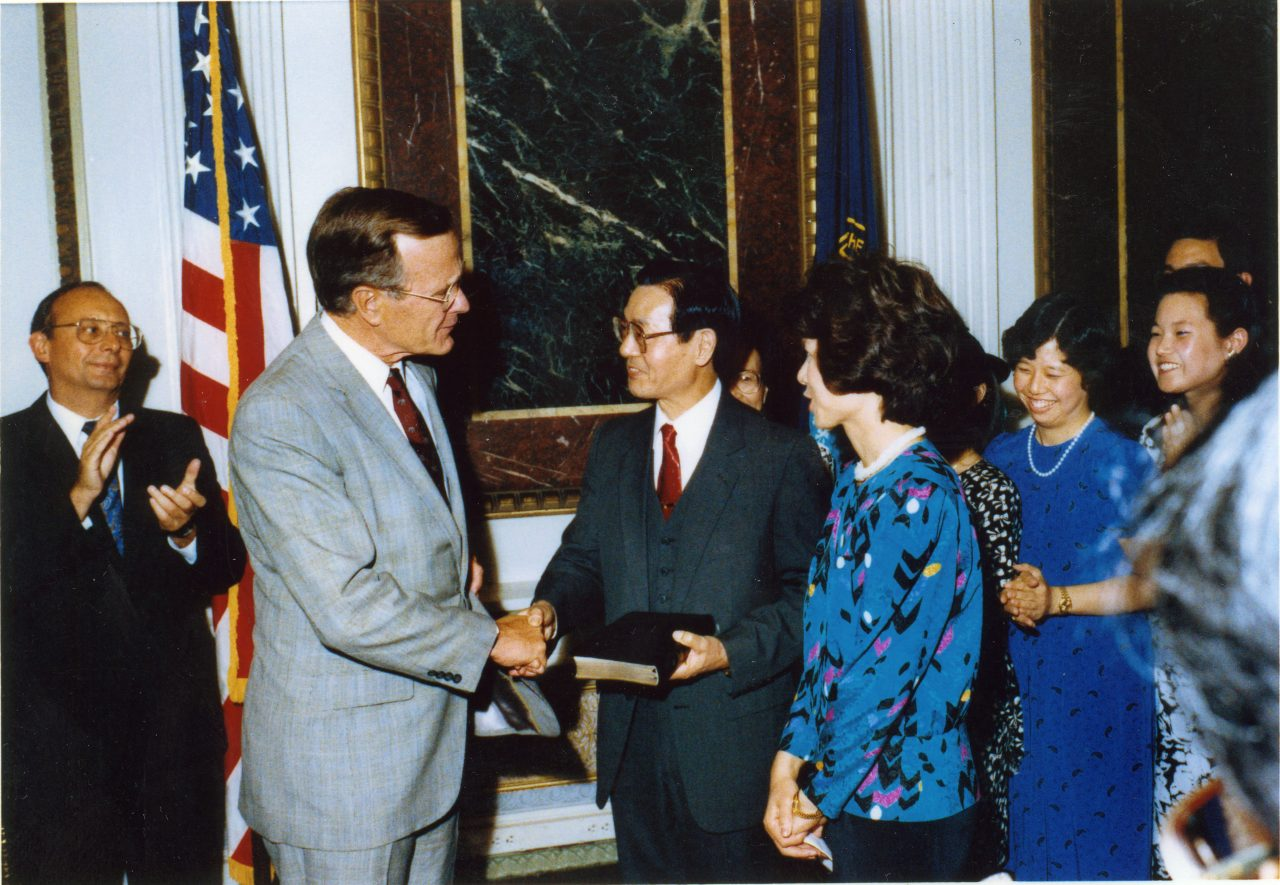 Vice President George H.W. Bush shakes hands with Dr. James S. C. Chao after swearing in Federal Maritime Commission Chairman Elaine Chao.