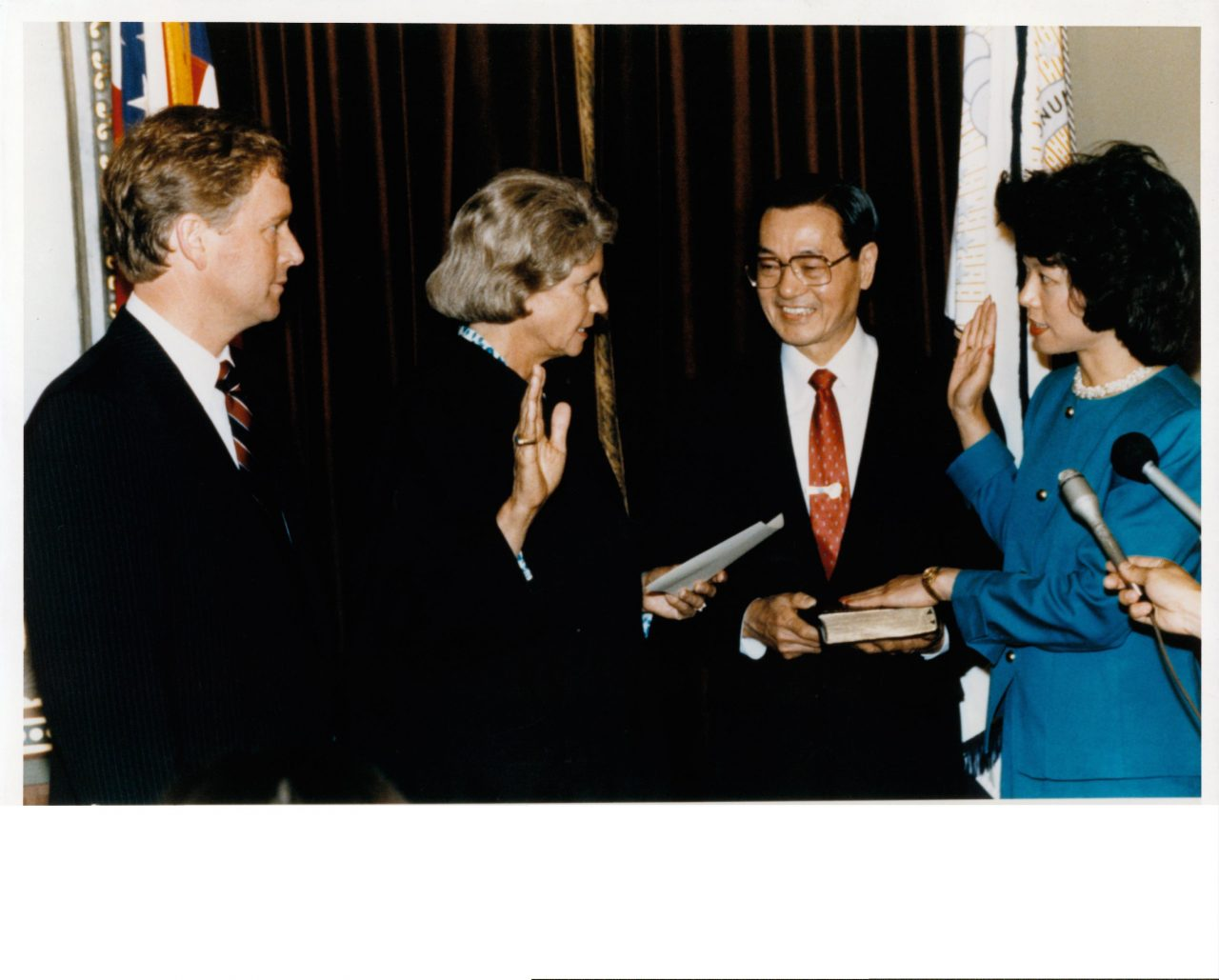 Elaine Chao being sworn in as U.S. Deputy Secretary of Transportation by Supreme Court Justice Sandra Day O'Connor with father, Dr. James S. C. Chao, holding the Bible and Vice President Dan Quayle witnessing.